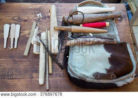 Tools For Making Wooden Instruments Zhaleyka, Flutes. Selective Focus. Folk Wooden Musical Instrumen