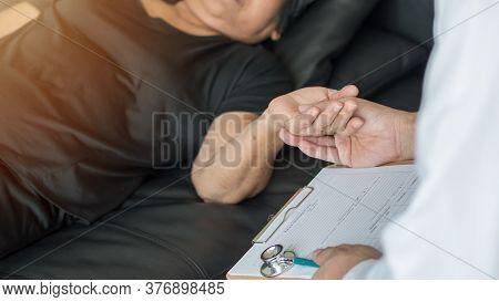 Parkinson Disease Patient, Alzheimer Elderly Senior, Arthritis Person's Hand In Support Of Geriatric
