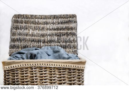 Large Laundry Basket Filled With Laundry On A White Background. Isolate.