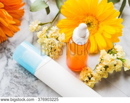 Skin Care Generic Products - White Pump Dispenser And Serum Or Essential Oil In Glass Bottle On Marb