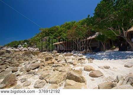 Photo Taken On A Wide Angle Lens, A Panoramic View Of The Bungalows And Stones At Low Tide The Sea O