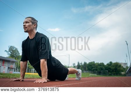 Young Athlete Push Up And Plank At Stadium Outdoor