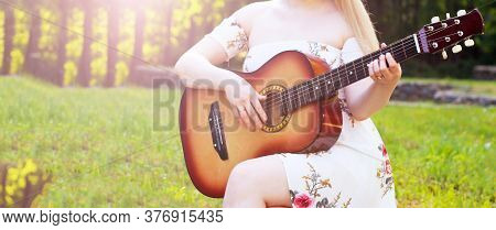 Beautiful Girl And Retro Guitar In The Garden, Outdoor