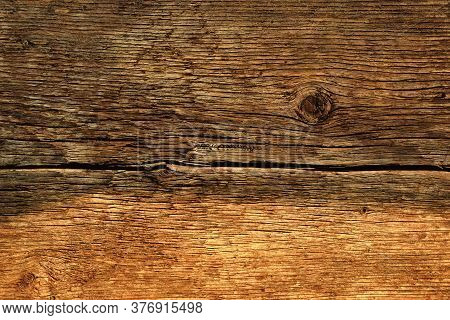 Wooden Texture - Old Cracked Boards, Half Lit By The Sun