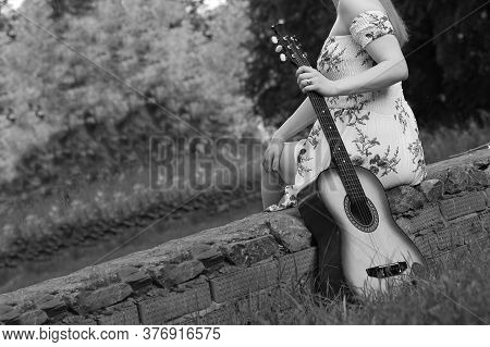 Beautiful Girl And Retro Guitar In The Garden, Black And White
