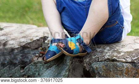 Child Feet On A Ladder On A Stone
