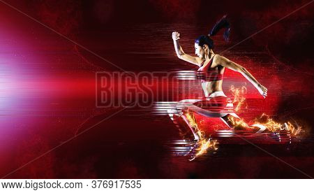 Woman sprinter leaving starting. Sports banner. Horizontal copy space background