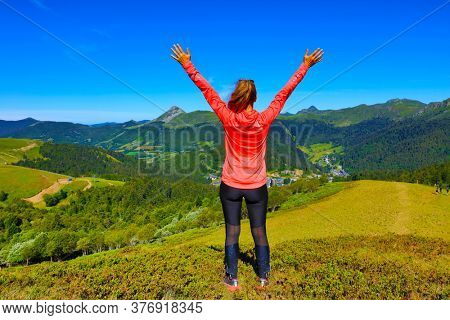 woman hiker on the top of mountain- Cantal in France
