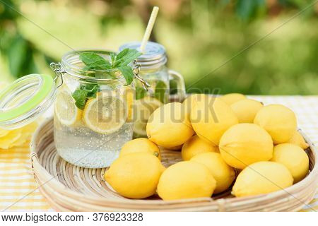 Plate With Ripe Fresh Lemons And Lemonade Sassy Water. Vitamins Concept. Copy Space. Strengthening I