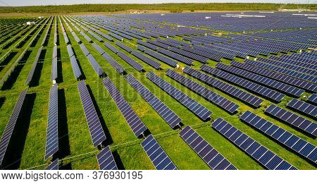 Long Perspective Of Long Perspective Over The Fight For Climate Change Over A Huge Solar Panel Farm