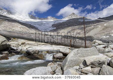 Provisional small bridge across a mountain stream