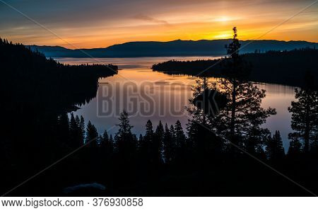 Sunrise Golden Hour Over Emerald Bay At Lake Tahoe California Usa View Of Silhouette Pine Trees As T