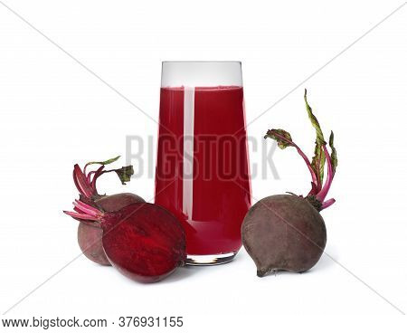 Fresh Beets And Juice Isolated On White