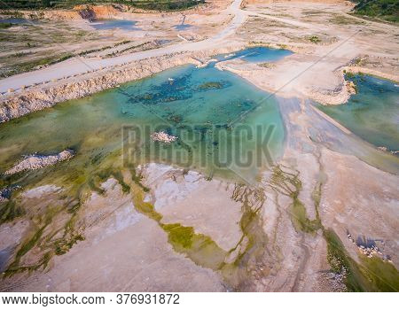 Aerial Drone View Of Mining Operation An Above Ground Open Pit Limestone Mine With Large Ponds Of Wa