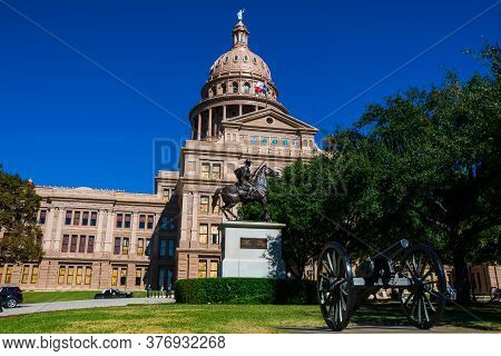 Texas State Capitol Building Under Perfect Sunny Days With Blue Sky In Austin Texas With Statue Of H