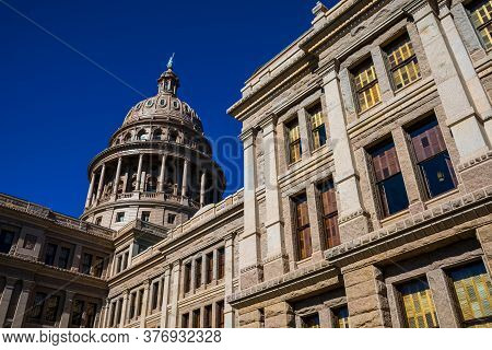 The Crown On Top Of The Texas State Capitol Building Under Perfect Sunshine And Deep Blue Sky Surrou
