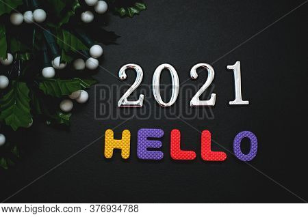 Hello 2021 - Word From Colored Letters, Happy New Year Concept, Black Background