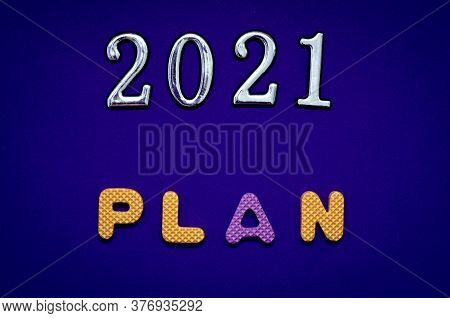 Plan 2021. Numbers 2021 With Colorful Alphabet Letter On Blue Background