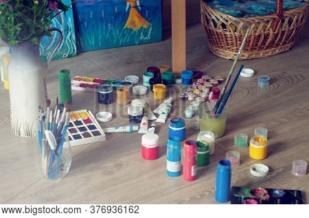 Set Of Watercolor Paints, Gouache, Paint Brushes On The Floor. Workshop In The Process Of Creativity