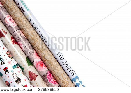 Flat Lay With Colorful Rolls Of Wrapping Paper On Table With Copy Space