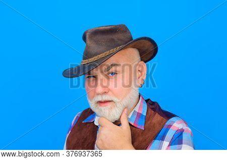 Portrait Of Bearded Man Wearing Cowboy Hat. Cowboy Couture. Western Style Men Fashion. Handsome Cowb