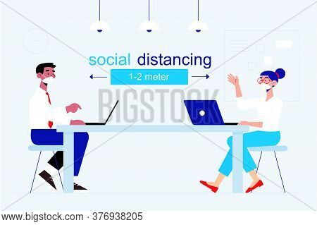 Social Distancing At Office Workplace. Employees Are Maintain Distance During Work At Workplace. Saf