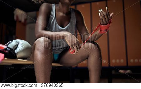 Wrapping hands for boxing. Boxer wearing  strap on wrist.Strong woman boxer.