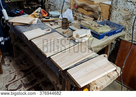 Carpentry Workshop With Tools For Woodworking, Workbench For Working With Boards, Dust Mask And Leat