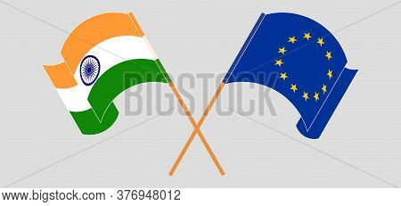Crossed And Waving Flags Of India And The Eu. Vector Illustration