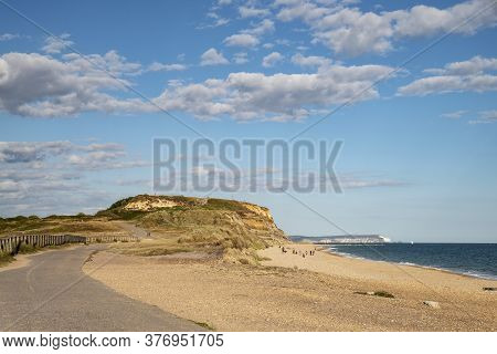 Beautiful Landscape Image Of Hengitsbury Head And Isle Of Wight In Distance On Summer Evening On Eng