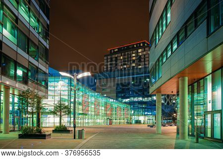 MANCHESTER, UK - FEB 24, 2020: Salford Quays business district at night in in Manchester, England, United Kingdom