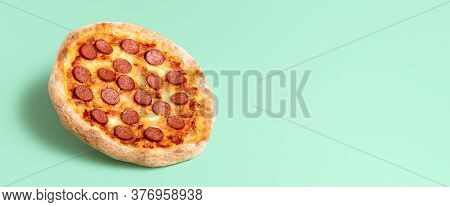 Tasty Homemade Pizza Pepperoni Isolated On A Mint Green Seamless Background. Promotional Banner For
