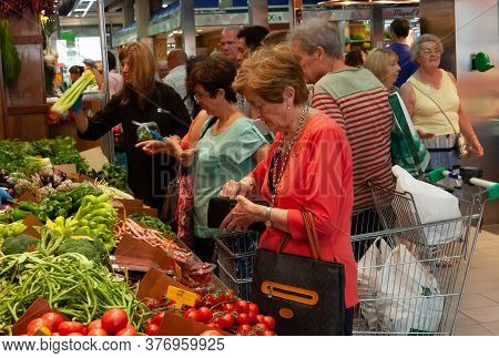 Palma De Mallorca, Balearic Islands/spain; July 2014: Older Women Buying And Paying At A Fruit And V