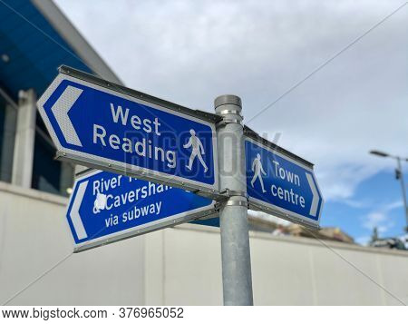READING, UK - JULY 18, 2020: Public direction signs for pedestrians arriving outside the main train station in Reading, Berkshire, UK.