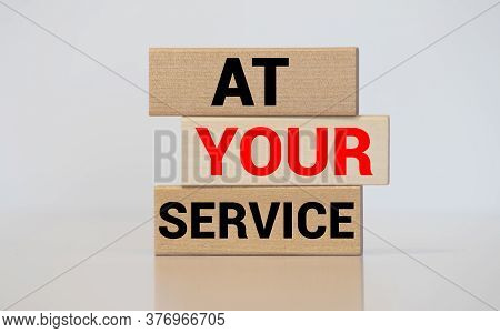 At Your Service Written On A Wooden Cube In Front Of A Telephone Conceptual Of Help, Client Services