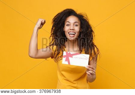 Laughing Young African American Woman Girl In Casual T-shirt Posing Isolated On Yellow Orange Wall B