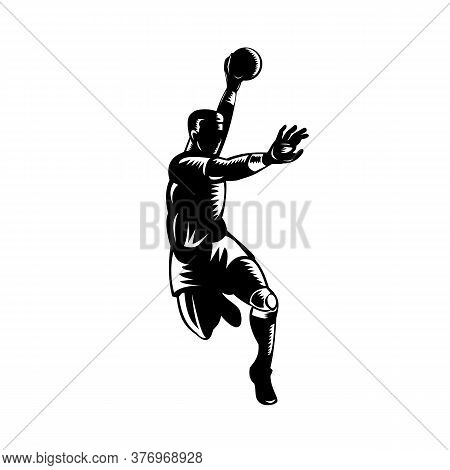 Retro Woodcut Style Illustration Of A European Handball Player, Also Known As Team Handball, With Ba