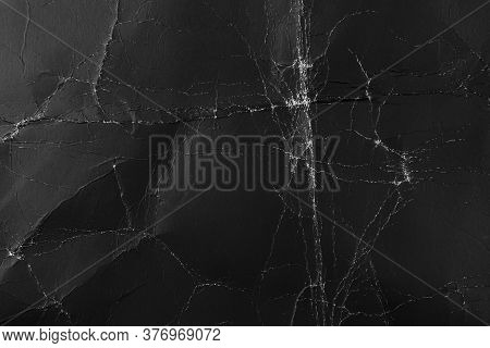 Worn Black Cardboard With Wrinkles And Scuffs. Paper Dark Abstract Background For Design. Packaging