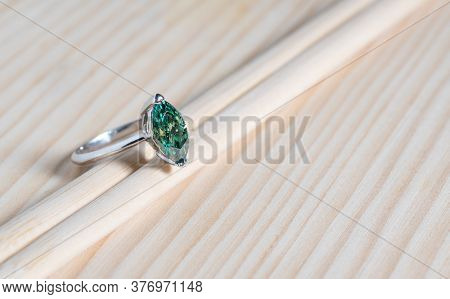 Aquamarine Engagement Ring On The Wooden Background