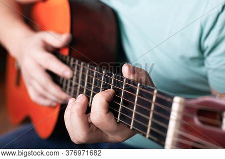 Playing The Acoustic Guitar Close-up, Hand Grips The Chord, Playing A Musical Instrument.