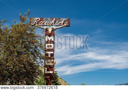 Jackson Hole, Wyoming - June 26, 2020: Old, Rustic Neon Sign For The Rawhide Motel