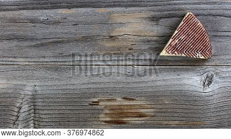 Fresh Cheese Wedge On Rustic Wood With Copy Space Available