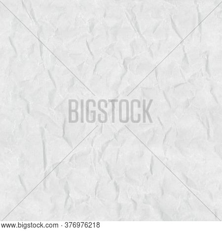 Smoothed crumpled and worn white paper. Empty blank paper texture. Seamless texture.