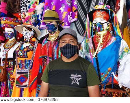 Cuenca, Ecuador - July 16, 2020: Seller In Mask Standing Next To Mannequins Dressed In National Cost