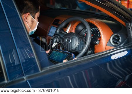 Checking A Car Engine Obd For Repair At Car Garage