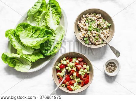 Ingredients For Cooking - Romaine Salad And Tuna, Egg, Tomato, Avocado Salad On A Light Background,