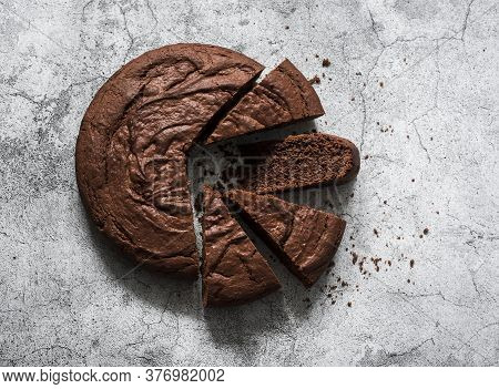 Chocolate Brownie Cake On A Grey Background, Top View. Copy Space
