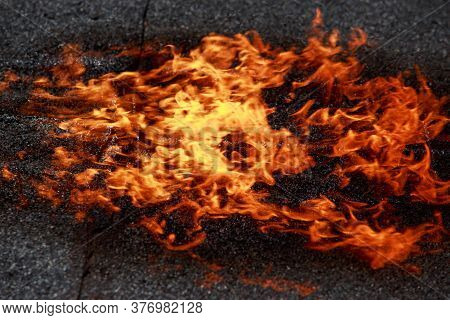 Fire On The Background Of Roofing Material