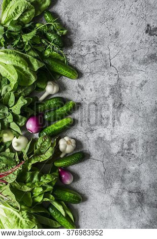 Fresh Organic Vegetables And Herbs Background. Cucumbers, Lettuce, Tarragon, Red Onion, Garlic, Roma