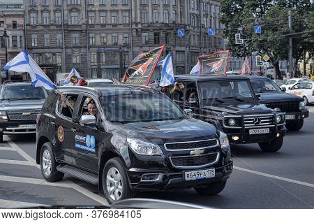 Parade Of Cars With The Flags Of The Marine Corps